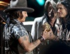 Johnny Depp accepts the the MTV Generation Award from Steven Tyler.