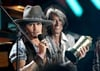 Johnny Depp accepts the the MTV Generation Award. Johnny also performed two songs with The Black Keys onstage.