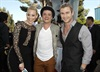 The Hunger Games co-stars Elizabeth Banks and Josh Hutcherson cosy up to The Avengers star Chris Hemsworth on the red carpet.