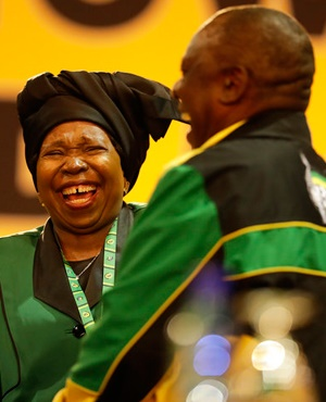 Front-runner and former wife of President Jacob Zuma, Nkosazana Dlamini-Zuma, and front-runner and Deputy President Cyril Ramaphosa share a laugh at the delayed start of the ANC elective conference. (Themba Hadebe, AP)