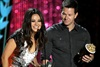 Mila Kunis and Mark Wahlberg present the award for best on-screen dirtbag - which went to Jennifer Aniston.