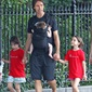 Phoenix Suns basketball star Steve Nash has his hands full off the court, too! Baby son Matteo is strapped to his chest and twins Lola and Bella each take a hand while strolling through a park in New York City.