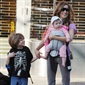 Trading Carrie for carry: SJP is looking understated and stylish on a walk to school with son James and baby Marion.