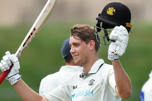 Cameron Green of Western Australia celebrates bringing up his century in a Sheffield Shield match against New South Wales in Adelaide on 21 October 2020.