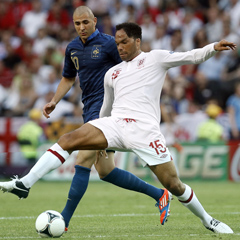 Joleon Lescott controls the ball in front of France's Karim Benzema (AP)
