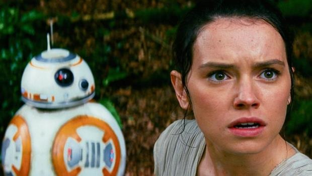 Daisy Ridley as Rey and BB-8 in a scene from Star Wars: The Force Awakens.