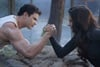 One of the most exciting things about Breaking Dawn Part 2 will be the first scenes of Bella Swan as a vampire. Here she arm wrestles with her brother-in-law Emmett Cullen.
