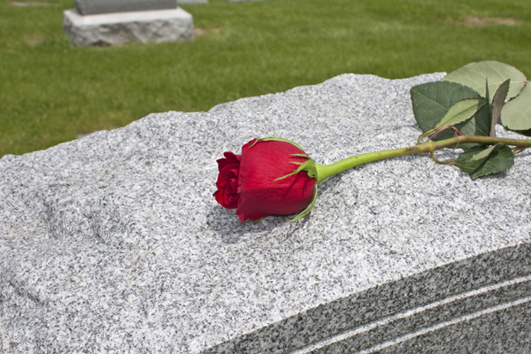 grave with rose