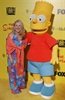 Nancy Cartwright who voices Bart Simpson in the famous sitcom, <em>The Simpsons</em>, was raised Roman Catholic but joined the Church of Scientology in the late 80s. She donated $10m to the church in '07 - wow!
