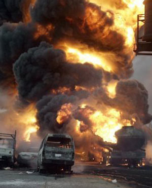 More than 100 people who went to scoop up oil from an overturned oil tanker in Nigeria have burned to death after the vehicle caught fire. (AFP)