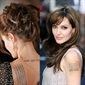 Angelina Jolie has a Buddhist Pali prayer on her back, which according to Freetattoodesigns.org protects her and her adopted son Maddox from bad luck. She also had the geographical coordinates of all her children's births tattooed on her arm.