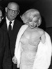 In this 19 May 1962 publicity photo, Marilyn Monroe arrives at Madison Square Garden to perform at a 45th birthday gala for President John F Kennedy. She is escorted by her former father in law, Isidore Miller. (AP Photo/Courtesy Running Press)