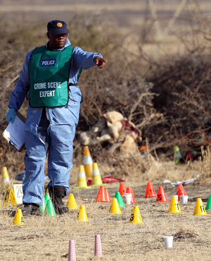 A forensic expert works at the scene of the Marikana killings. (Picture: AP)