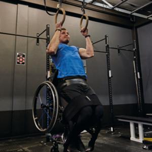 Alwyn Uys exercising in his wheelchair