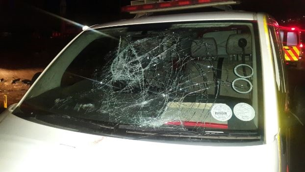 An EMS ambulance was damaged on Saturday when paramedics were attacked in Slangspruit at night. The attackers smashed the windscreen and bashed doors of the ambualance.