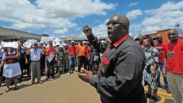 National Education, Health and Allied Workers' Union deputy regional chairperson Mdunge Mganu spurs on Northdale Hospital staff during picket action in the parking lot.