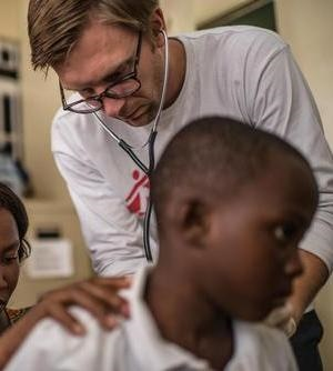 5 year old Ebola survivor in a checkup with doctor Jostein Heggeboe in the MSF survivor clinic in Freetown, Sierra Leone