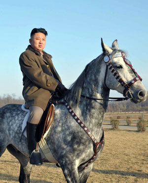 North Korean leader Kim Jong-Un riding a horse as he inspects the training ground of a horse riding company under the Korean People's Army. (KCNA VIA KNS/ AFP)