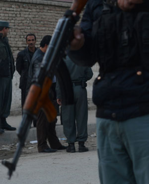 Afghan policemen stand guard near the site of a Taliban suicide bomber attack in Kabul. (File, AFP)