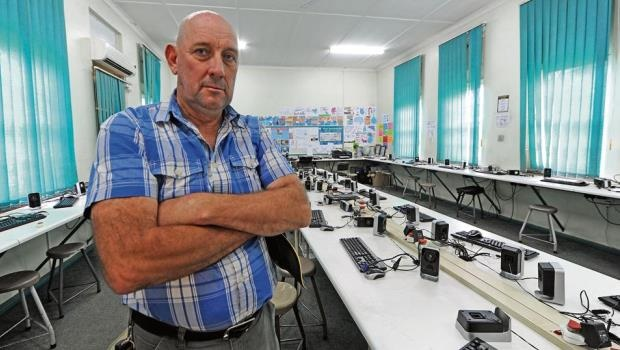 Maintenance manager Justin James stands in an empty computer room at Scottsville Primary School yesterday after the school was looted by thieves of more than 40 computers in a brazen early morning heist.