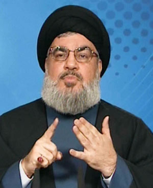 Manar TV shows Hezbollah leader Hassan Nasrallah delivering a televised speech from an undisclosed location in Lebanon. (AFP/MANAR TV)