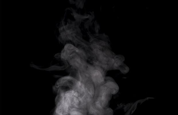 A cloud of steam against black background
