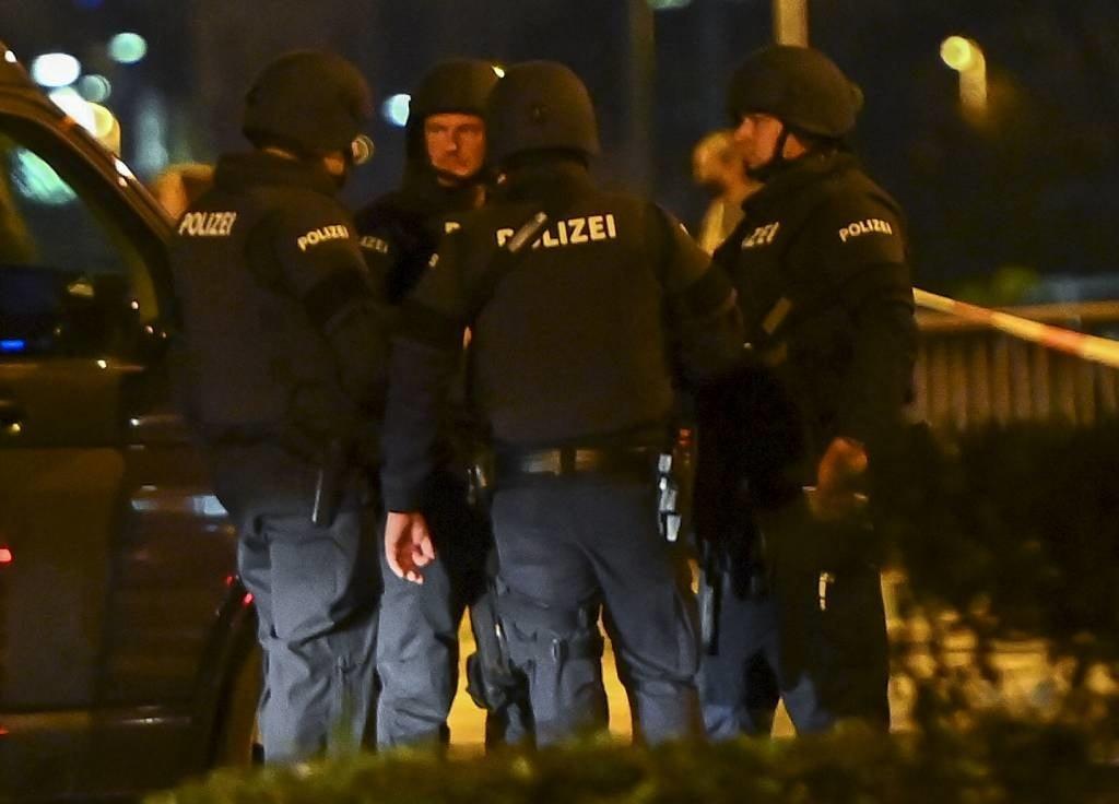 Police stand guard stand near Schwedenplatz square
