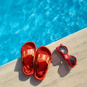shoes next to swimming pool