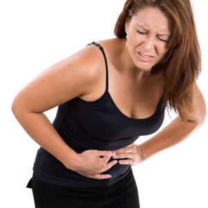 Woman with stomach cramps from diarrhoea
