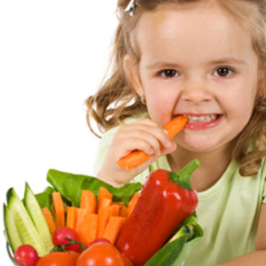 Girl eating vegetables