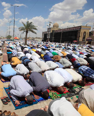 Followers of Shiite cleric Muqtada al-Sadr pray during Friday prayers in the Shi'ite stronghold of Sadr City in Baghdad, Iraq. (Karim Kadim, AP)