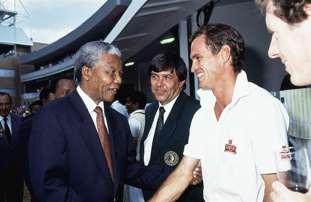 mandela with nick price and greg norman celebrating the
