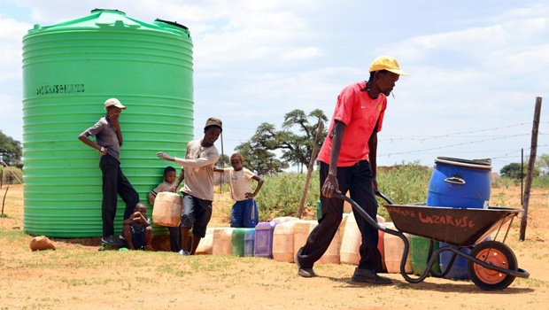 Residents of Setlagole village in Ratlou Local Municipality, North West, braving the scorching hot sun as they queue for water at a tank, which is filled by state-supplied trucks.