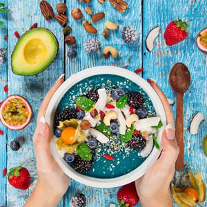 woman holding vegan smoothie bowl