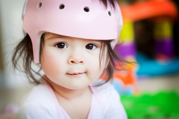Baby in helmet