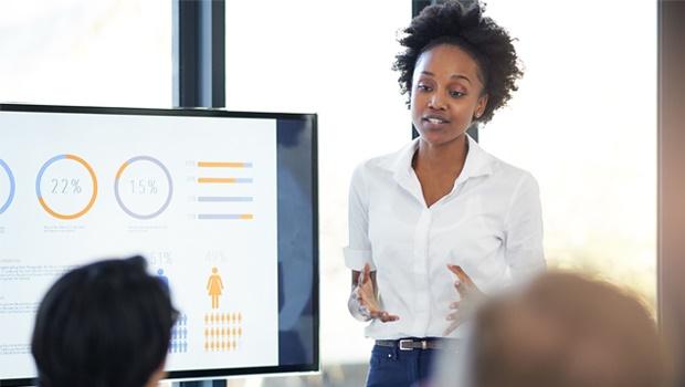 A woman presenting an idea in a work meeting.