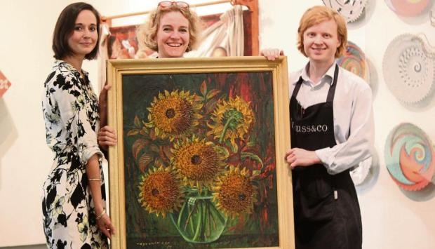 Strauss & Co fine arts specialists with a rare Vladimir Tretchikoff painting found in Pietermaritzburg.