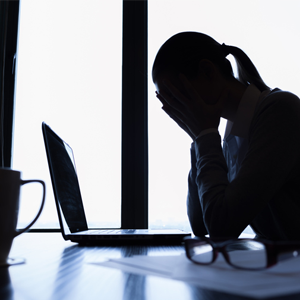 Depressed woman in office