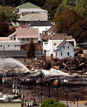 Wreckage is strewn through the downtown core in Lac-Megantic, Quebec, after a train derailed, igniting tanker cars carrying crude oil. (The Canadian Press, Ryan Remiorz/ AP)