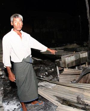 A Muslim man shows his burnt residence in Htan Gone village of Kantbalu township, Sagaing division Myanmar. (File, AP)