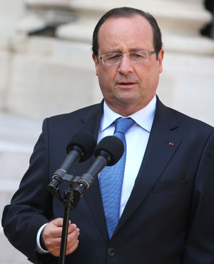France's President Francois Hollande speaks during a press conference after a meeting with the President of the National Coalition for Syrian Revolutionary and Opposition Forces (SNC) at the Elysee presidential palace. (Kenzo Tribouillard, AFP)