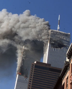 Smoke rising from the burning twin towers of the World Trade Center after hijacked planes crashed into the towers, in New York City. (File, AP)