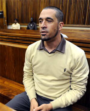 Jean-Pierre Malan appears in the Randburg Magistrate's Court along with his girlfriend, Maruschka Robinson, in connection with the murder of a man whose body was found in his car at Montecasino in Fourways. (Werner Beukes, Sapa)