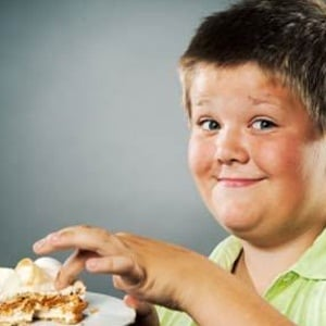 By the time they're seven, obese kids may suffer from emotional problems.