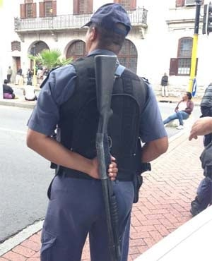A police officer stands guard in Cape Town CBD. (Nielen de Klerk, News24)