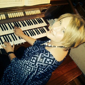 Hearing impaired Caren Yssel plays the organ