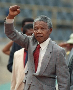 Mandela raises clenched fist, arriving to address mass rally, a few days after his release from jail, 25 February 1990, in  Bloemfontein. (Trevor Samson, AFP)