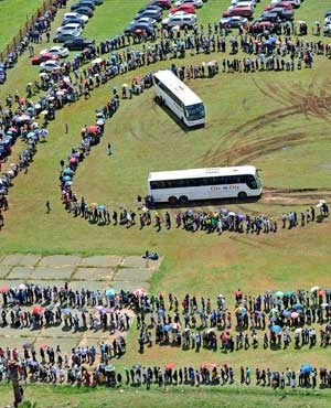People queue for busses before heading to the Union Buildings in Pretoria. (Picture: AP)