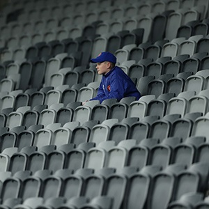 a ballkid sits in the stands watching an A-League game in Sydney (getty)