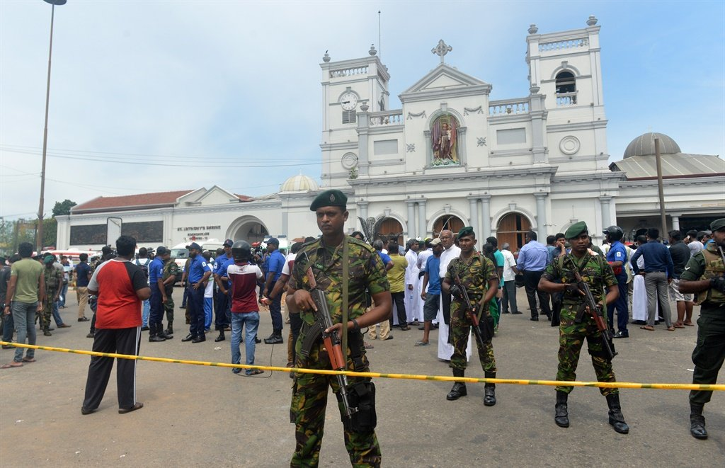 Sri Lankan security personnel keep watch outside the church premises following a blast at the St. Anthony's Shrine in Kochchikade, Colombo on April 21, 2019. (AFP)